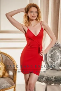 Slim blonde Melany in figure hugging red dress