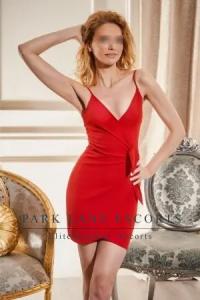 Slim blonde Melany in figure hugging red dress
