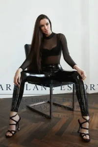 High end escort Cindy in tight black leather trousers